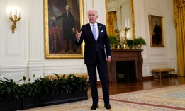 President Biden answers a question from a reporter after he spoke about COVID-19 vaccine requirements for federal workers Thursday.