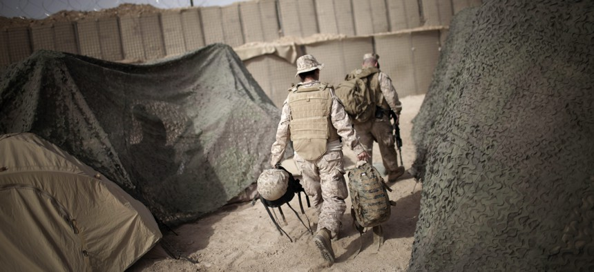 An interpreter follows a U.S. Marine officer prior to moving to another military base in Marjah, Helmand province, southern Afghanistan, on March 21, 2010.