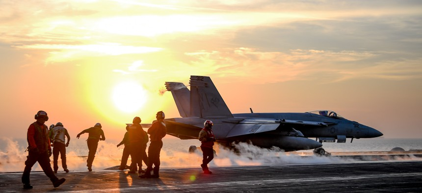 An F/A-18E Super Hornet launches from the flight deck of the aircraft carrier USS Theodore Roosevelt in the Persian Gulf, Feb. 5, 2018.