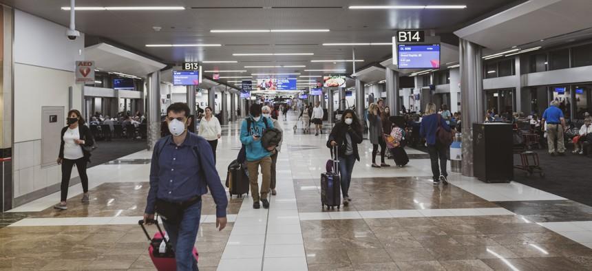 Passengers at Hartsfield-Jackson Atlanta International Airport walk inside a terminal in March 2021.