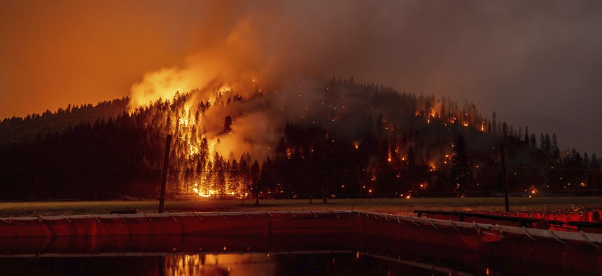 flames from the Dixie Fire spread in Genesee, Calif., on Saturday, Aug. 21.