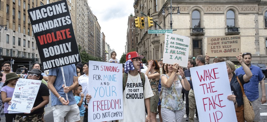 People gather to protest recent mandates requiring vaccines against the coronavirus in New York on Saturday.
