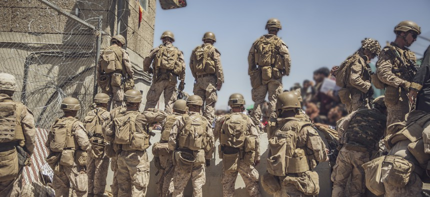 U.S. Marines assist with security at an Evacuation Control Checkpoint at Hamid Karzai International Airport, Kabul, Afghanistan, Aug. 26, 2021.