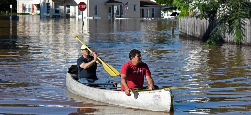 Residents canoe through floodwater in the aftermath of Hurricane Ida in Manville, N.J., on Thursday.