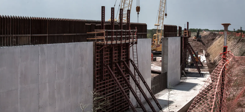 Construction continues on what the federal government says is a levee improvement project in the Rio Grande Valley. Local immigrant advocates and environmentalists say it looks suspiciously like a border wall.