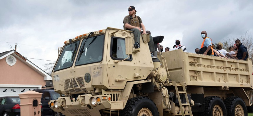 Soldiers with the Louisiana National Guard conduct search and rescue missions in Laplace, La, Aug. 30, 2021, during the recovery from Hurricane Ida.