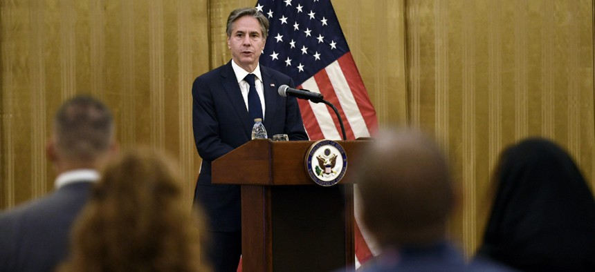 Secretary of State Antony Blinken speaks to members of the U.S. embassy and Mission Afghanistan in the Qatari capital Doha on Tuesday.