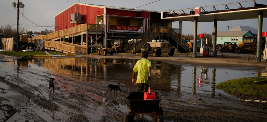 A man goes for gas at a hurricane-damaged gas station in the aftermath of Hurricane Ida on September 6 in Grand Isle, La.