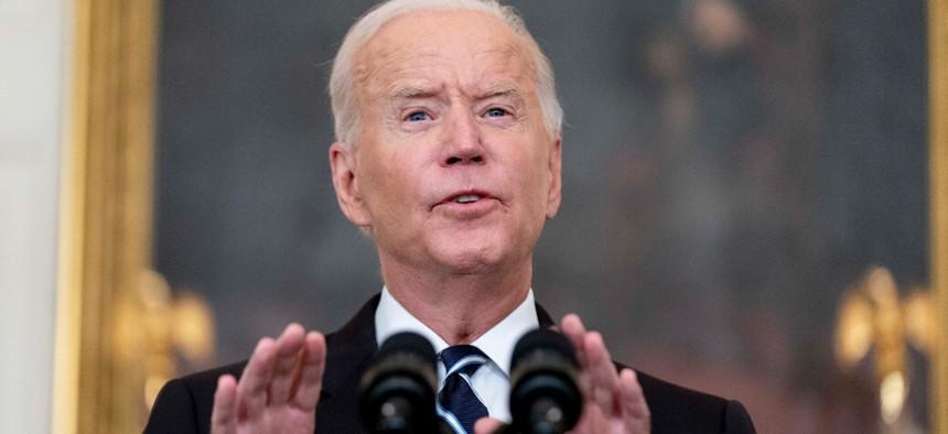 President Biden speaks in the State Dining Room at the White House on Thursday.