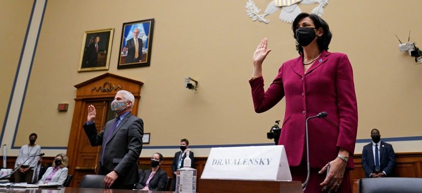 Dr. Anthony Fauci, the nation's top infectious disease expert, and Centers for Disease Control and Prevention Director Dr. Rochelle Walensky are sworn in before testifying at a House Select Subcommittee hearing on April 15.