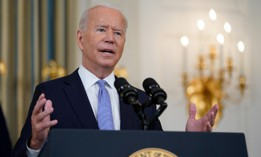 President Biden speaks about the COVID-19 response and vaccinations in the State Dining Room of the White House on Friday.
