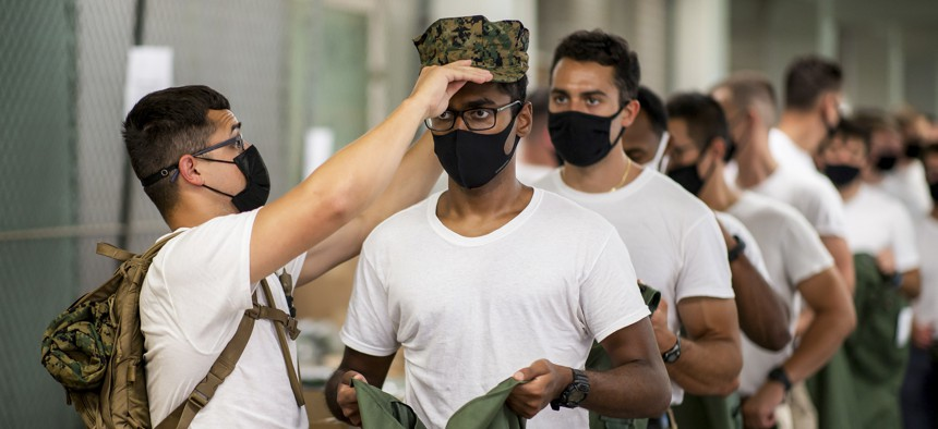 Marine Corps officer candidates receive uniform items upon arriving at Officer Candidates School at Marine Corps Base Quantico, Va., Sept. 13, 2021.