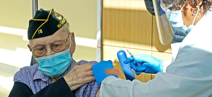 U.S. Army veteran Gene Moy, 103, of Seattle, receives the second shot of the Pfizer COVID-19 vaccination in February.