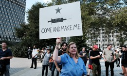 People participate in a rally and march against COVID-19 vaccine mandates on September 13 in New York City.