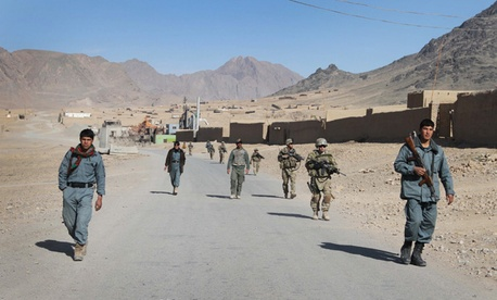 Afghan policemen and U.S. soldiers patrol Kandahar in January.