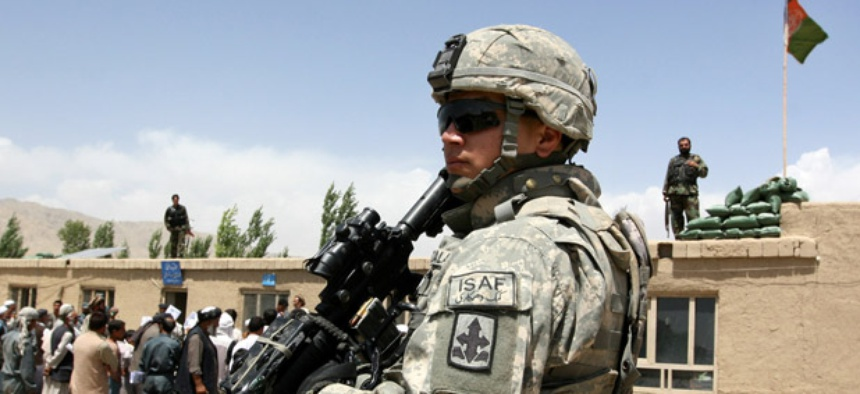 A U.S. soldier stands guard in Ghazni province, where more troops will be moved soon, according to reports.