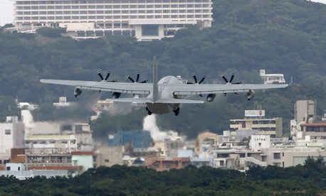 A transport plan flies into a base in Okinawa.