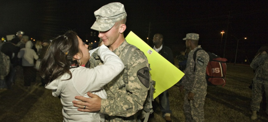 Gerald Kowalski hugs his wife Lisa as he returns home.