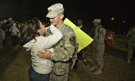 Gerald Kowalski hugs his wife Lisa as he returns home.