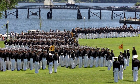 Midshipmen march onto Worden Field at the United States Naval Academy in Annapolis, Md. for the annual Commissioning Week Color Parade in 2009.
