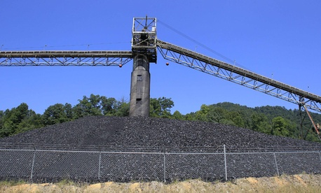 Coal lies in piles around a conveyor system at a Kentucky mine.