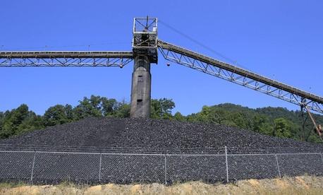Coal lies in piles around a conveyor system at a Kentucky mine.