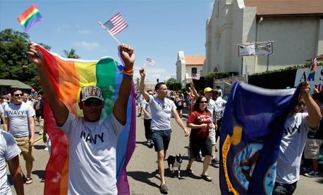 A former Navy sailor participates in a gay pride parade in San Diego.