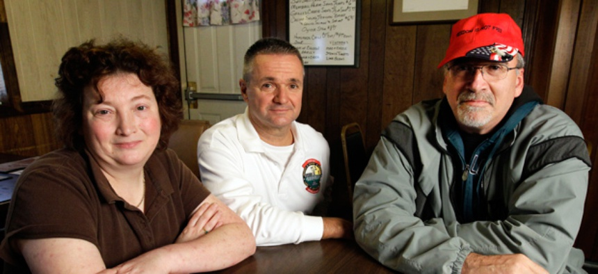 Dover Air Force Base mortuary employees Mary Ellen Spera, Bill Zwicharowski, and James Parsons.