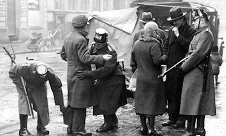 The actual Gestapo searches a German couple.