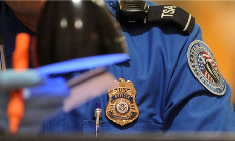 A TSA officer checks ID at Hartsfield-Jackson Atlanta International Airport in 2011.