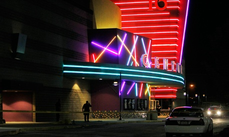 Police gather outside the Century 16 movie theatre in Colorado where 12 people were killed.