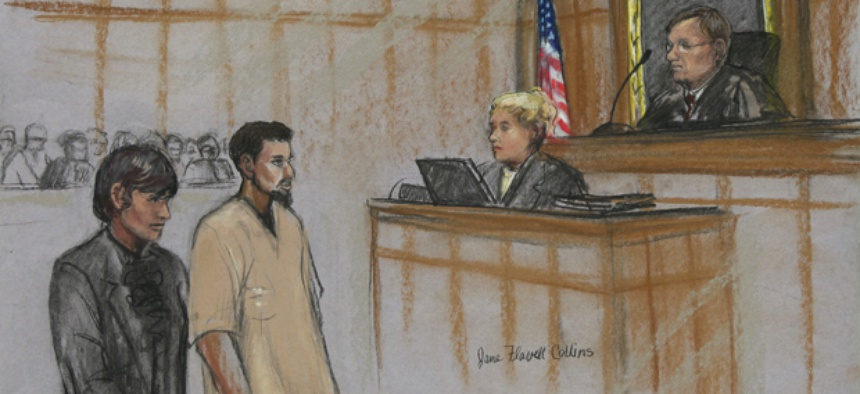 Rezwan Ferdaus, second left, and his attorney Catherine Byrne, left, stand during Ferdaus' arraignment hearing in federal court in October.