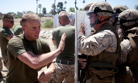 Marines in Bravo Company of the 1st Law Enforcement Battalion practice non-lethal crowd control techniques.