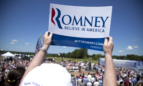 A Mitt Romney supporter holds a sign during a New Hampshire rally.