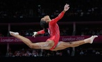 U.S. gymnast Gabrielle Douglas performs on the balance beam at the 2012 Summer Olympics.