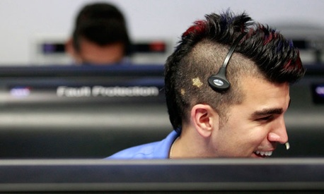 NASA's Bobak Ferdowsi, who cuts his hair differently for each mission, wore a mohawk for Curiosity's landing.