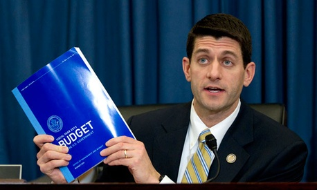 Rep. Paul Ryan, R-Wis., holds up Barack Obama's budget in February.