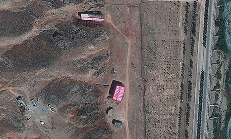 Analysts say te Parchin military complex is being shrouded with a pink tarp to stop the U.N nuclear agency from monitoring Tehran's efforts to develop a weapon.