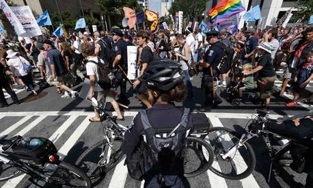 Police observe protestors Monday in Charlotte.