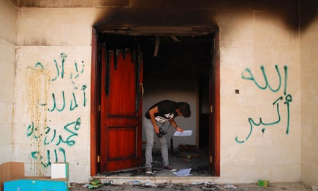 A Libyan looks at documents at the U.S. consulate in Benghazi after the attack