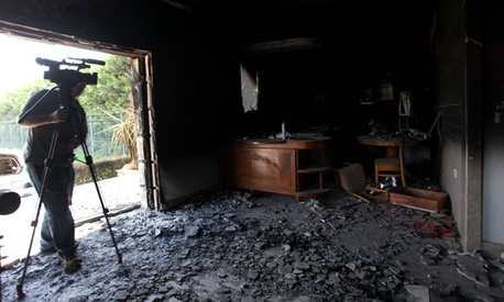 A man films the interior of the United States Consulate in Benghazi, Libya after an attack killed embassy workers.