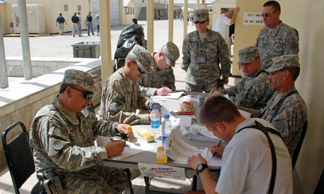 Soldiers filling out voter absentee ballots at Camp Phoenix in Kabul, Afghanistan.