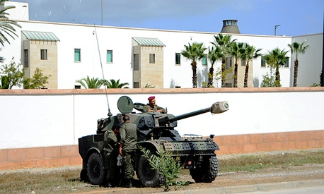 Tunisian police and army vehicles surround the U.S. Embassy in Tunisia.