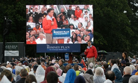 Mitt Romney campaigned in the Ohio rain Friday.