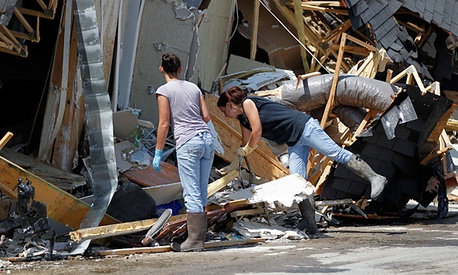 People search for belongings after their home was destroyed by Hurricane Issac.