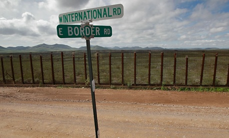 The agents were shot near the border in Nacos, Ariz.