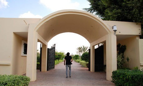 A Libyan man walks on the grounds of the U.S. Consulate in Benghazi after it was attacked last month.