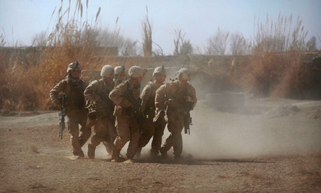 Marines carry a colleague wounded by an IED in Afghanistan in 2011.