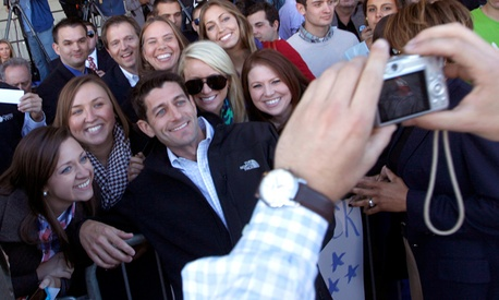 Republican vice presidential candidate, Rep. Paul Ryan, R-Wis., poses for pictures with supporters.