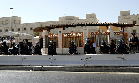 Jordanian riot police stand guard during a protest outside the U.S. embassy in Amman, Jordan.